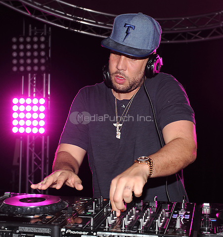 NEW ORLEANS, LA - JULY 2: DJ Drama spins at the 2015 Essence Festival Day Party at the Sugar Mill on July 2, 2015 in New Orleans, Louisiana. Credit: PGFM/MediaPunch