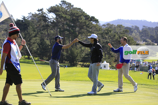 Adam Hadwin (USA) sinks his putt on the 13th green at Pebble Beach Golf Links during Sunday's Final Round 4 of the 2017 AT&amp;T Pebble Beach Pro-Am held over 3 courses, Pebble Beach, Spyglass Hill and Monterey Penninsula Country Club, Monterey, California, USA. 12th February 2017.<br /> Picture: Eoin Clarke | Golffile<br /> <br /> <br /> All photos usage must carry mandatory copyright credit (&copy; Golffile | Eoin Clarke)