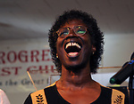 Close up of Theresa Neely, singing with the New Pro Choir, at Kingston's 2nd Juneteenth Celebration, sponsored by the Kingston Chapter of ENJAN (End the New Jim Crow Action Network) and New Progressive Baptist Church, and held at the church in Kingston on Saturday, June 14, 2014. Photo by Jim Peppler. Copyright Jim Peppler 2014 all rights reserved.