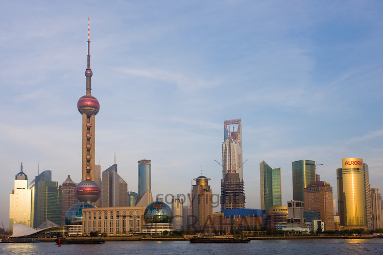 View of the Pudong financial and business district and Huangpu River from the Bund, Shanghai, China