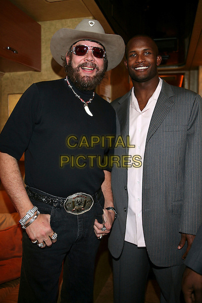 HANK WILLIAMS JR. & CHAMP BAILEY.The NFL Alumni Awards held at the Seminole Hard Rock,.Hollywood, Florida, USA, 2 February 2007..half length hat sunglasses beard.CAP/ADM/RR.©Randi Radcliff/AdMedia/Capital Pictures.