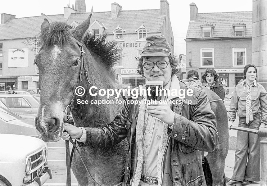 25 year old West German, Alfons Damm, nick-named &ldquo;The Happy Wanderer&rdquo; in local people in Co Donegal, Rep of Ireland, pictured with his trusty stead, Bob, in the Diamond in Co Donegal. The government employee is a regular visitor to Ireland. He says: &ldquo;I am going to book Bob again next year&rdquo;. Alfons stays in guest houses. And he says there is never a problem getting a nice green field for Bob. 1978050105b<br /><br />Copyright Image from Victor Patterson, 54 Dorchester Park, <br />Belfast, UK, BT9 6RJ<br /><br />t1: +44 28 9066 1296 (from Rep of Ireland 048 9066 1296)<br />t2: +44 28 9002 2446 (from Rep of Ireland 048 9002 2446)<br />m: +44 7802 353836<br /><br />victorpatterson@me.com<br />www.victorpatterson.com<br /><br />Please see my Terms and Conditions of Use at VICTORPATTERSON.COM. It is IMPORTANT that you familiarise yourself with them.<br /><br />Images used on the Internet must be visibly watermarked i.e. &copy;VICTORPATTERSON.COM within the body of the image and copyright metadata must not be deleted. Images used on the Internet have a size restriction of 4kbs and are chargeable at the then current NUJ rates.<br /><br />This image is only available for the use of the download recipient i.e. television station, newspaper, magazine, book publisher, etc, and must not be passed on to any third party. It is also downloaded on condition that each and every usage is notified within 7 days to victorpatterson@me.com<br /><br />The right of Victor Patterson to be identified as the author is asserted in accordance with The Copyright Designs And Patents Act (1988).