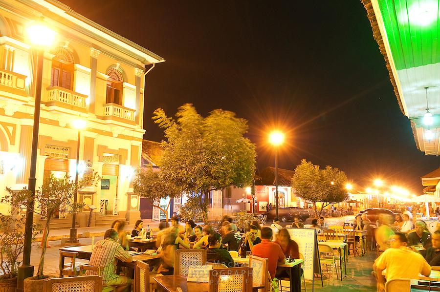 Cafe views along Calle La Calzada at dusk, Granada, Nicaragua
