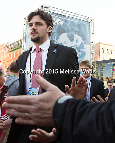 Robbie Baillargeon (BU - 19), TJ Ryan (BU - 3) - The teams walked the red carpet through the Fan Fest outside TD Garden prior to the Frozen Four final on Saturday, April 11, 2015, in Boston, Massachusetts.
