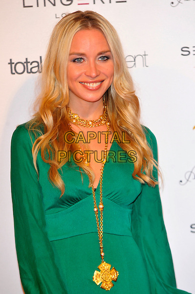 Noelle Reno.Lingerie London held at Old Billingsgate, London, England..October 24th, 2012.half length green dress gold necklace .CAP/CJ.©Chris Joseph/Capital Pictures.