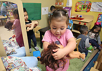 NWA Democrat-Gazette/DAVID GOTTSCHALK Abbygail Gonzalez, 3, plays with her doll Monday, March 12, 2018, in the Arkansas Better Chance Toddler Room at the Northwest Arkansas Sunshine School and Development Center in Little Flock. The school has been serving the area for more than 50 years.