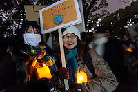 Japanese woman support Democrats at a protest march by members of the Democratic Party Abroad organisation to mark the inauguration of President Donald Trump, Tokyo, Japan. Friday January 20th 2017 Around 400 people took apart in the march, which started in Hibiya Park at 6:30pm and finished in Roppongi just before 8pm, to honour the service given by President Obama and to protest against the illiberal policies expected of the new administration of President  Trump.