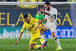 Denis Cheryshev of Villarreal CF battles for the ball with  Daniel Carvajal Ramos (r) of Real Madrid during their La Liga match between Villarreal CF and Real Madrid at the Estadio de la Cerámica on 26 February 2017 in Villarreal, Spain. Photo by Maria Jose Segovia Carmona / Power Sport Images