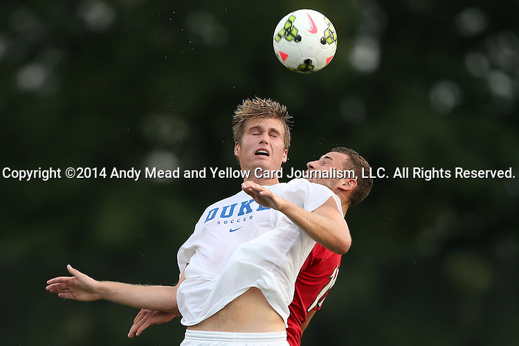 19 August 2014: Duke's Nat Eggleston (left) and Radford's Kryzystof Nalborski (POL) (right) challenge for a header. The Duke University Blue Devils hosted the Radford University Highlanders at Koskinen Stadium in Durham, NC in a 2014 NCAA Division I Men's Soccer preseason match.