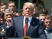 United States President Donald J. Trump makes remarks as he presents the Commander-in-Chief's Trophy to the U.S. Military Academy football team in the Rose Garden of the White House in Washington, DC on Tuesday, May 1, 2018.  The Commander-in-Chief's trophy is presented to the winner of the annual Army-Navy football game which was played at Lincoln Financial Field in Philadelphia, Pennsylvania on December 9, 2017.  The Army Black Knights beat the Navy Midshipmen 14 - 13.<br /> Credit: Ron Sachs / CNP