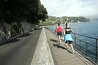 Uno scorcio della strada panoramica tra Portofino e Santa Margherita Ligure.<br /> Joggers make their way along the corniche road from Portofino to Santa Margherita Ligure, Liguria, Northern Italy.<br /> UPDATE IMAGES PRESS/Riccardo De Luca