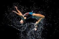 An Italian synchronised swimmer jumps during her Free Combination final at the 15th FINA World Aquatics Championships in Barcelona, Spain, August 13, 2010.