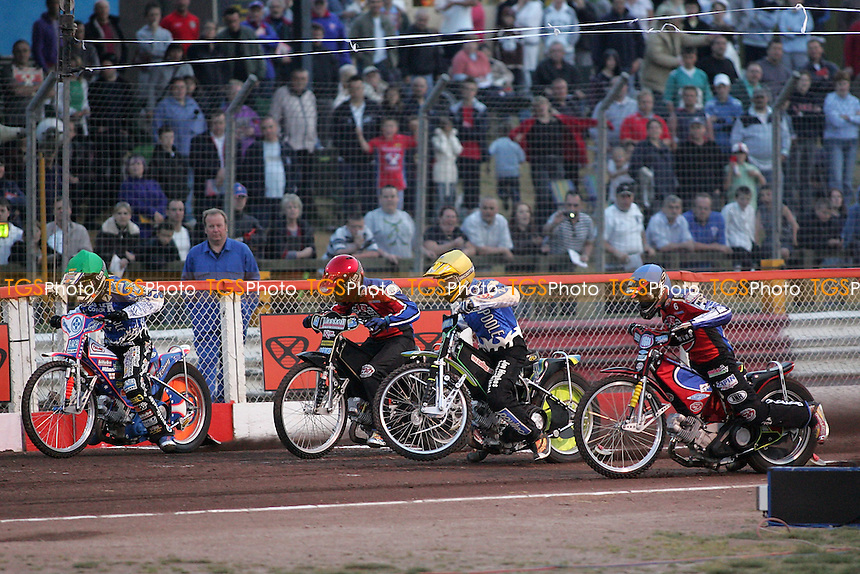 A large crowd watches a speedway meeting between Lakeside Hammers and Poole Pirates at the Arena Essex Raceway, Purfleet - 16/04/07 - MANDATORY CREDIT: Gavin Ellis/TGSPHOTO. Self-Billing applies where appropriate. NO UNPAID USE. Tel: 0845 094 6026