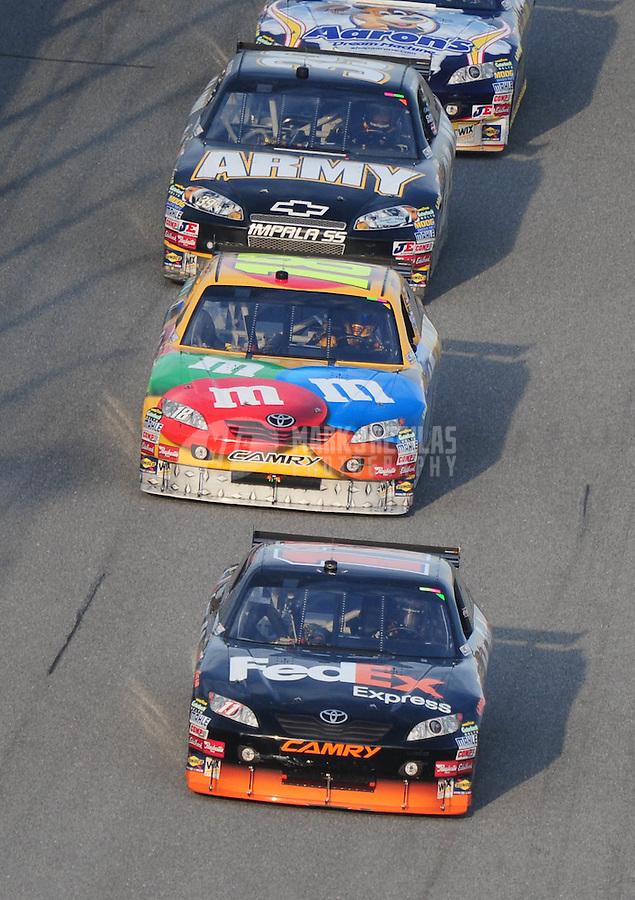 Feb 12, 2009; Daytona Beach, FL, USA; Nascar Sprint Cup Series driver Denny Hamlin leads Kyle Busch during race two of the Gatorade Duel at Daytona International Speedway. Mandatory Credit: Mark J. Rebilas-