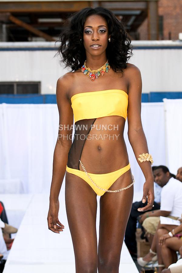 Model walks runway in a Moorscode swimsuit by Moe Moorscode, during the JRG Bikini Under The Bridge 2012 fashion show on July 9, 2012.