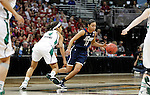01 APRIL 2012:  Bria Hartley (14) of the University of Connecticut dribbles past Skylar Diggins (4) of the University of Notre Dame during the Division I Women's Final Four Semifinals at the Pepsi Center in Denver, CO.  Notre Dame defeated UCONN 83-75 to advance to the national championship game.  Jamie Schwaberow/NCAA Photos