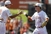 Texas Longhorns second baseman Brooks Marlow (8) celebrates with teammate Alex Silver (11) following the NCAA Super Regional baseball game against the Houston Cougars on June 7, 2014 at UFCU Disch–Falk Field in Austin, Texas. The Longhorns are headed to the College World Series after they defeated the Cougars 4-0 in Game 2 of the NCAA Super Regional. (Andrew Woolley/Four Seam Images)