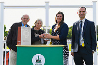 Connections of Ablaze receive their trophy for winning  The Smith & Williamson Handicap (Class 6)  during Afternoon Racing at Salisbury Racecourse on 17th May 2018
