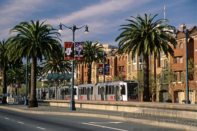 Muni Light Rail transit train and apartments in the South Beach - Mission Bay area of San Francisco, California