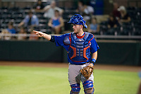 AZL Cubs catcher Marcus Mastrobuoni (5) points towards starting pitcher Alfredo Colorado (not pictured) as he walks off the field between innings against the AZL Giants on September 5, 2017 at Scottsdale Stadium in Scottsdale, Arizona. AZL Cubs defeated the AZL Giants 10-4 to take a 1-0 lead in the Arizona League Championship Series. (Zachary Lucy/Four Seam Images)