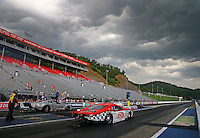 Jun 21, 2015; Bristol, TN, USA; Robert Rahaim red lights in the final round against NHRA pro mod driver Rickie Smith (near lane) during the Thunder Valley Nationals at Bristol Dragway. Mandatory Credit: Mark J. Rebilas-