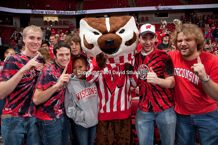 November 11, 2009: Wisconsin Badgers Bucky Badger poses with fans during an NCAA basketball exhibition game against the UW-Superior Yellowjackets at the Kohl Center on November 11, 2009 in Madison, Wisconsin. The Badgers won 80-47. (Photo by David Stluka)