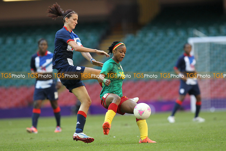 Jill SCOTT of Great Britain and Reine SOSSO of Cameroon - Great Britain Women vs Cameroon Women - Womens Olympic Football Tournament London 2012 Group E at the Millenium Stadium, Cardiff, Wales - 28/07/12 - MANDATORY CREDIT: Gavin Ellis/SHEKICKS/TGSPHOTO - Self billing applies where appropriate - 0845 094 6026 - contact@tgsphoto.co.uk - NO UNPAID USE.