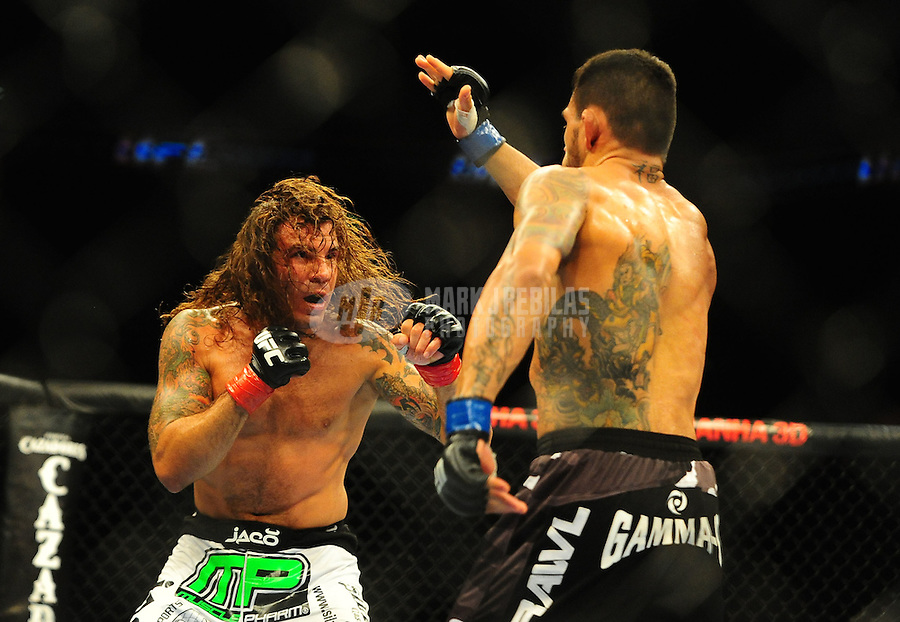 """Aug. 7, 2010; Oakland, CA, USA; UFC fighter Clay Guida (left) against Rafael Dos Anjos during the lightweight """"swing"""" bout in UFC 117 at the Oracle Arena. Mandatory Credit: Mark J. Rebilas"""
