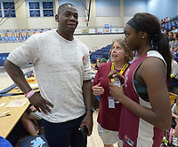 NWA Democrat-Gazette/ANDY SHUPE<br /> Ronnie Brewer (from left), a former Fayetteville High School, University of Arkansas and NBA basketball player, shares advice with Springdale coach Heather Hunsucker and Springdale standout and Arkansas commitment Marquesha Davis Tuesday, Sept. 18, 2018, during the first Campaign Tipoff for the United Way of Northwest Arkansas' campaign in Wildcat Arena at Har-Ber High School in Springdale. This year's goal for the agency is approximately $1.8 million