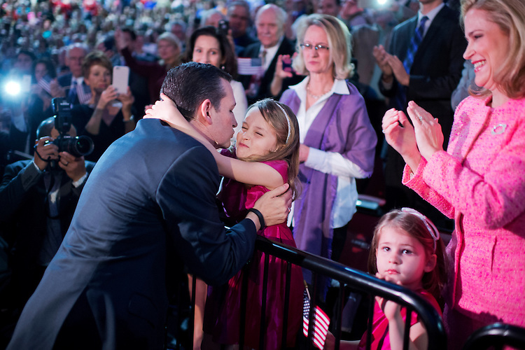UNITED STATES - MARCH 23: Sen. Ted Cruz, R-Texas, hugs his daughter Caroline, 6, as his other daughter Catherine, 4, and wife Heidi, look on, during a convocation at Liberty University's Vines Center in Lynchburg, Va., where he announced his candidacy for President of the United States, March 23, 2015. (Photo By Tom Williams/CQ Roll Call)