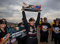 Mar 29, 2014; Las Vegas, NV, USA; NHRA pro stock driver Erica Enders-Stevens celebrates after winning the K&N Horsepower Challenger during the Summitracing.com Nationals at The Strip at Las Vegas Motor Speedway. Mandatory Credit: Mark J. Rebilas-USA TODAY Sports