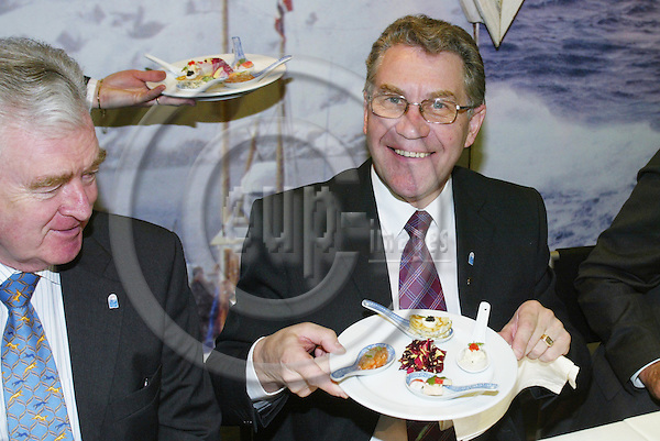 BRUSSELS - BELGIUM - 26 APRIL 2005 --European Seafood Exposition--The Norwegian Minister for Fishery Svein LUDVIGSEN at the exposition with a seafood plate.-- PHOTO: ERIK LUNTANG / EUP-IMAGES..