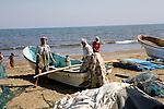 Sohar, Sultanate of Oman. January 31th 2009..Fishmen on the beach of Sohar.