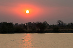 Sun setting over Kafue River, Kafue National Park, Zambia
