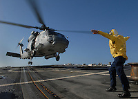 An SH-60 with Secretary of the Navy Donald Winter aboard lands aboard USS Shoup.