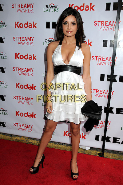 MIKEALA HOOVER .The 2nd Annual Streamy Awards held at the Orpheum Theatre, Los Angeles, California, USA, 11th April 2010 .full length white dress tiered ruffle cleavage halterneck black platform shoes open toe waistband .CAP/ADM/BP.©Byron Purvis/AdMedia/Capital Pictures.