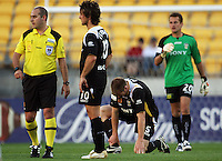 Karl Dodd (2nd right) holds his ankle after injuring it. Beside him (from left) are referee Craig Zetter, Michael Ferrante and Glen Moss during the A-League match between Wellington Phoenix and Newcastle Jets at Westpac Stadium, Wellington, New Zealand on Sunday, 4 January 2009. Photo: Dave Lintott / lintottphoto.co.nz