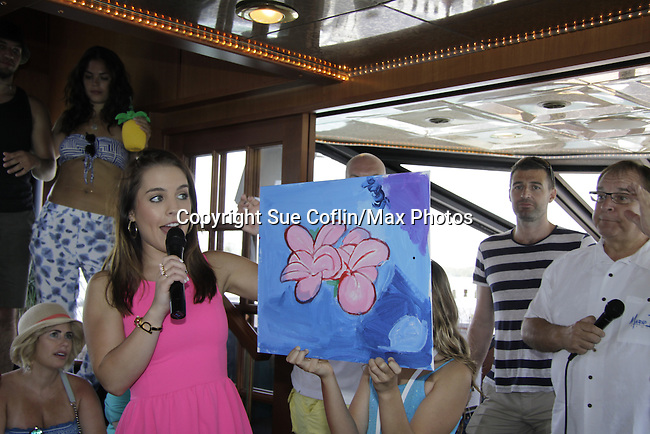 Kristen Alderson auctions off her painting as she donated time at 15th Southwest Florida Soapfest 2014 Charity Weekend - at Cruisin' and Schmoozin' on May 25, 2104 aboard the Marco Island Princess (boat), Marco Island, Florida.  (Photo by Sue Coflin/Max Photos)