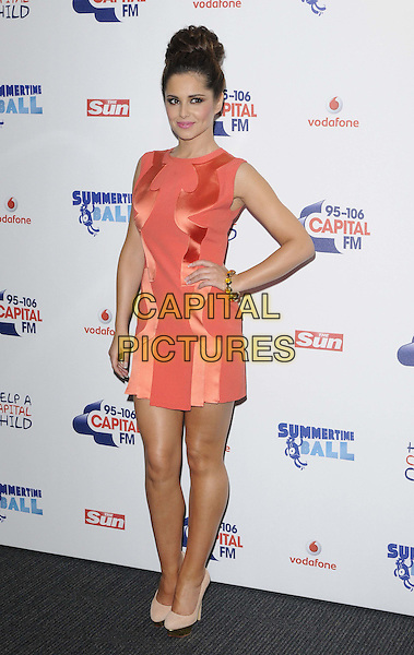 Cheryl Cole.attended the Capital Radio FM Summertime Ball, Wembley National Stadium, Wembley, London, England, 9th June 2012..arrivals full length orange dress sleeveless hand on hip beige cream shoes .CAP/CAN.©Can Nguyen/Capital Pictures.