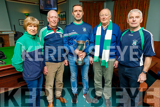 Cathy Carey, Donal Lucey, Donal Rooney, Sean O'Connor and Michael Herlihey celebrating Na Gaeil's All Ireland Junior Club Championship win in the clubhouse on Monday.