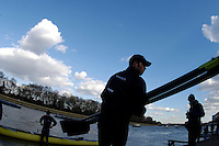 PUTNEY, LONDON, ENGLAND, 05.03.2006, Oxford prepare to boat. Pre 2006 Boat Race Fixtures,.   © Peter Spurrier/Intersport-images.com.OUBC, Bow Robin Esjmond-Frey, No.2 Colin Smith, No.3 Jake Wetzel, No.4 Paul Daniels, No.5 James Schroeder. No.6 Barney Williams, No. 7 Tom Parker, stroke Bastien Ripoll, and cox Nick Brodie,..[Mandatory Credit Peter Spurrier/ Intersport Images] Varsity Boat Race, Rowing Course: River Thames, Championship course, Putney to Mortlake 4.25 Miles Sunrise, Sunsets, Silhouettes