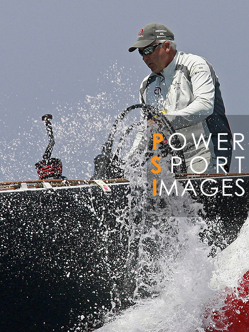25 May 2006, Valencia, Spain --- America's Cup defender Alinghi's skipper Brad Butterworth of New Zealand steers the boat during their match-race against challenger Victory Challenge of Sweden at the Louis Vuitton Act 12 in Valencia, eastern Spain. Photo by Victor Fraile / The Power of Sport Images