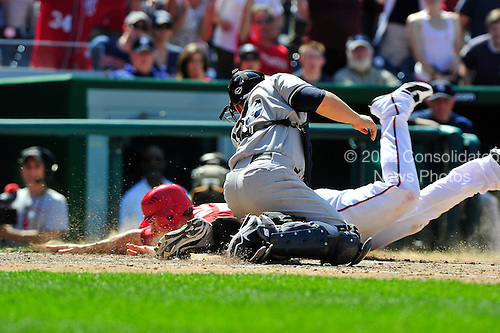 New York Yankees catcher Russell Martin (55) applies the tag to Washington Nationals first baseman Tyler Moore (57) in the eighth inning at Nationals Park in Washington, D.C. on Saturday, June 16, 2012.  The Yankees won the game in 14 innings 5 - 3..Credit: Ron Sachs / CNP.(RESTRICTION: NO New York or New Jersey Newspapers or newspapers within a 75 mile radius of New York City)