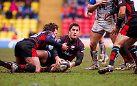 Brad Barritt looks to pass the ball off the floor. Guinness Premiership match between Saracens and Bath on February 28, 2010 at Vicarage Road in Watford, England. [Mandatory Credit: Patrick Khachfe/Onside Images]