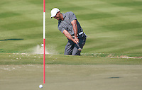 Tiger Woods (USA) chips out of a greenside bunker on the 2nd hole during Saturday's Round 3 of the HSBC Golf Championship at the Abu Dhabi Golf Club, United Arab Emirates, 28th January 2012 (Photo Eoin Clarke/www.golffile.ie)