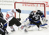 Lincoln Griffin (NU - 19), Jayson Argue (Bentley - 32) - The visiting Bentley University Falcons defeated the Northeastern University Huskies 3-2 on Friday, October 16, 2015, at Matthews Arena in Boston, Massachusetts.