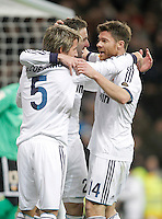 Real Madrid's Fabio Coentrao celebrates with Gonzalo Higuain and Xabi Alonso during King's Cup match. January 15, 2013. (ALTERPHOTOS/Alvaro Hernandez) /NortePhoto