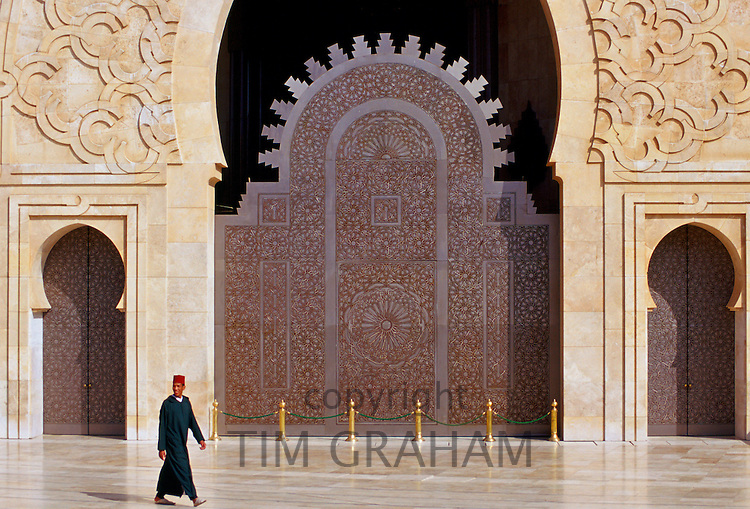 Man walking outside Hassan II Mosque in Casablanca, Morocco