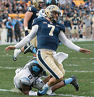 Pitt quarterback Tom Savage (7) was injured on this play when tackled by North Carolina player Norkeithus Otis (8).The North Carolina Tar Heels defeated the Pitt Panthers 34-27 at Heinz Field, Pittsburgh Pennsylvania on November 16, 2013.