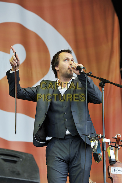 Bellowhead.Performing live at BBC Radio 2 Live in Hyde Park, London, England..September 11th, 2011.stage concert live gig performance music half length black grey gray suit jacket singing .CAP/MAR.© Martin Harris/Capital Pictures.